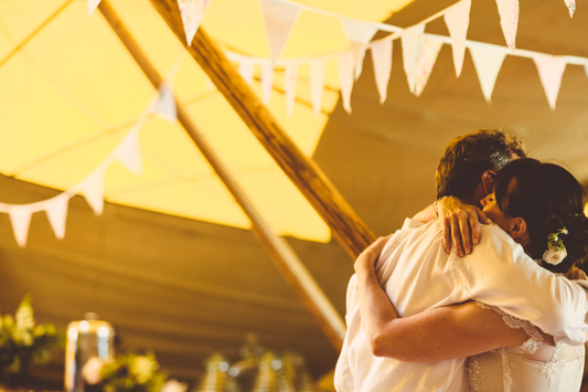 festival wedding by london wedding photographer with candy anthony dress