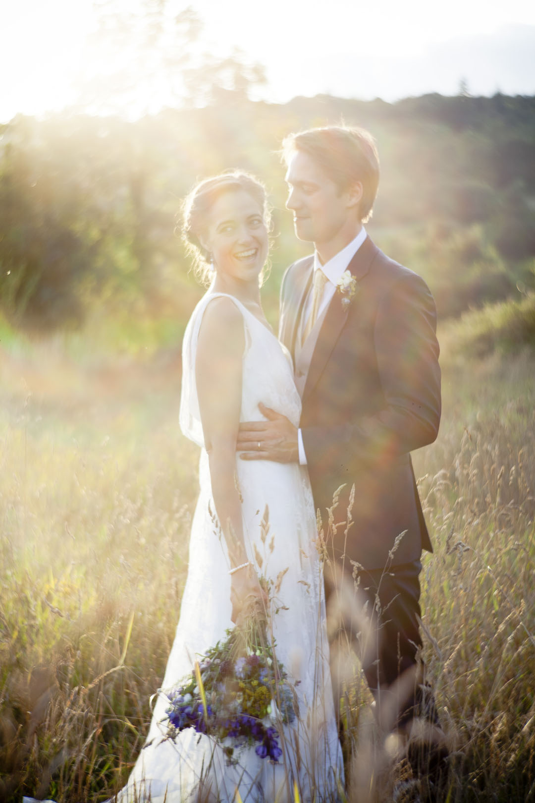 festival style outdoor wedding in a rustic barn and meadow