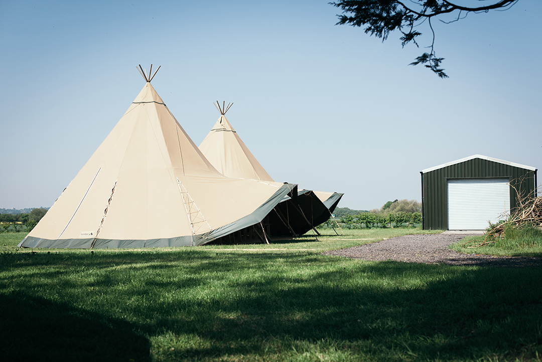 wedding tipis at a outdoor festival style wedding