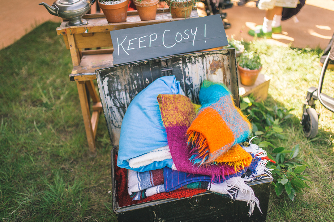 blankets to keep warm at an outdoor festival wedding