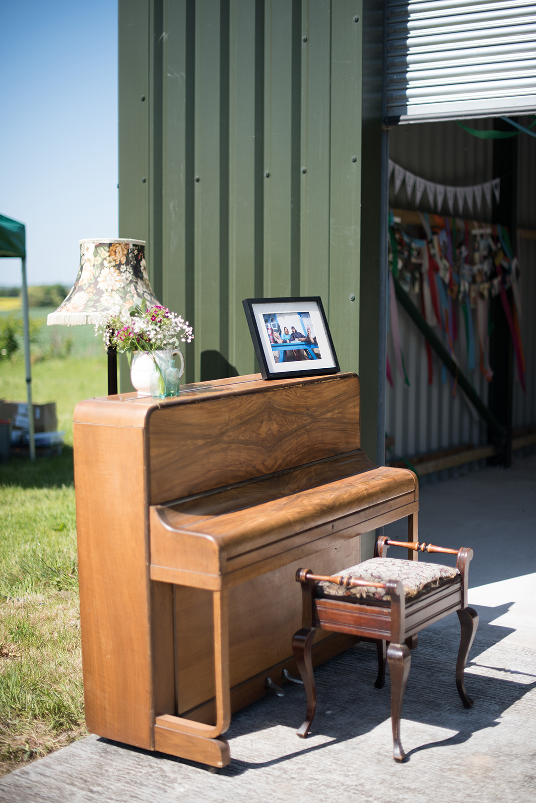 piano and decor at an outdoor wedding ceremony