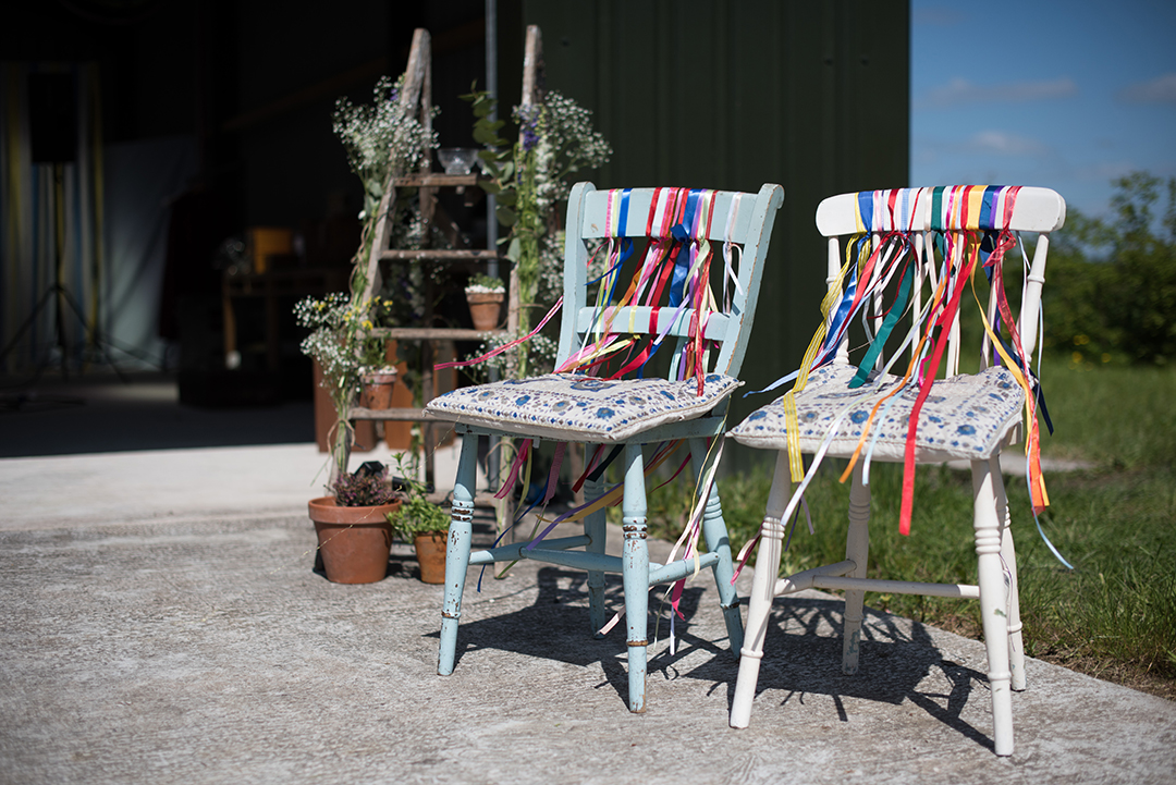 ceremony chairs and wedding decor at a festival style wedding
