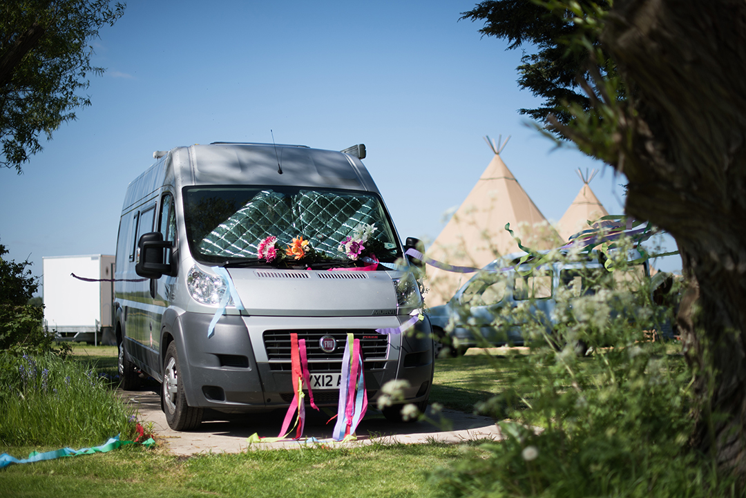 camper van and tipi at a festival style wedding