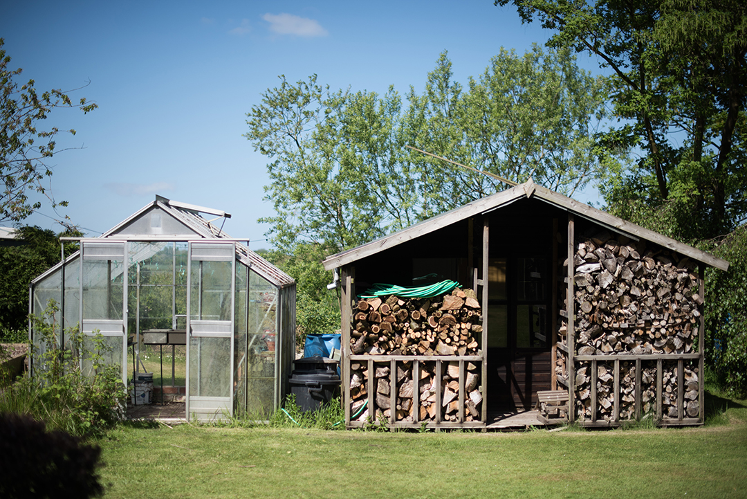 glass house and log shed at a festival style wedding
