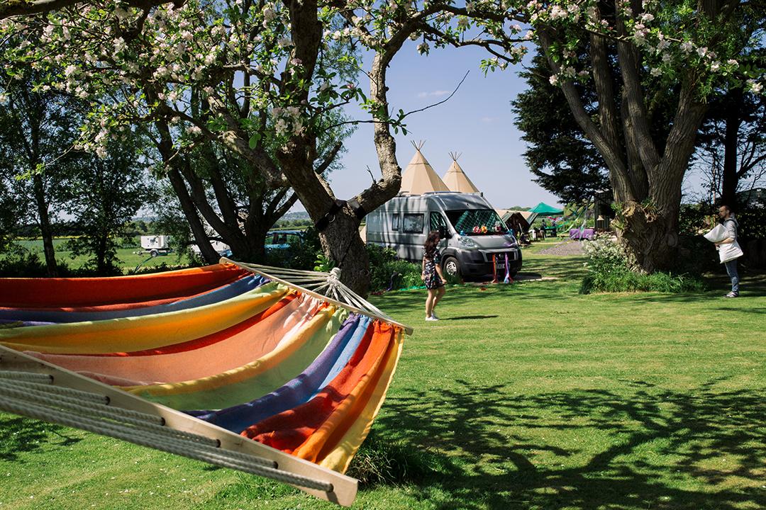 colourful hammock at a festival style wedding