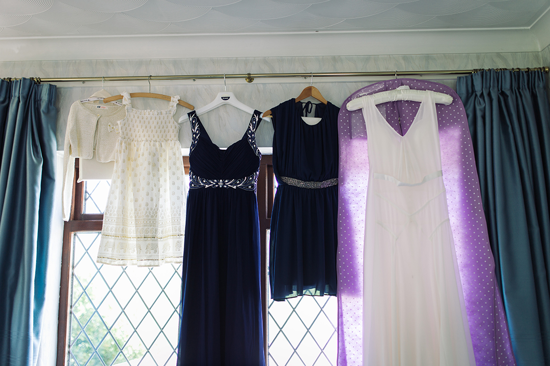 wedding dress, purple bridemaids dresses and flower girl dress