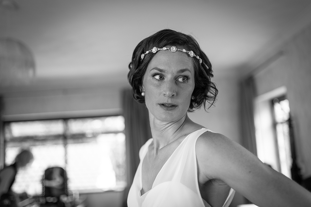 bride with a bohemian head piece at a festival style wedding