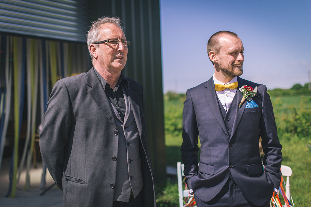groom with bow tie at a festival style wedding