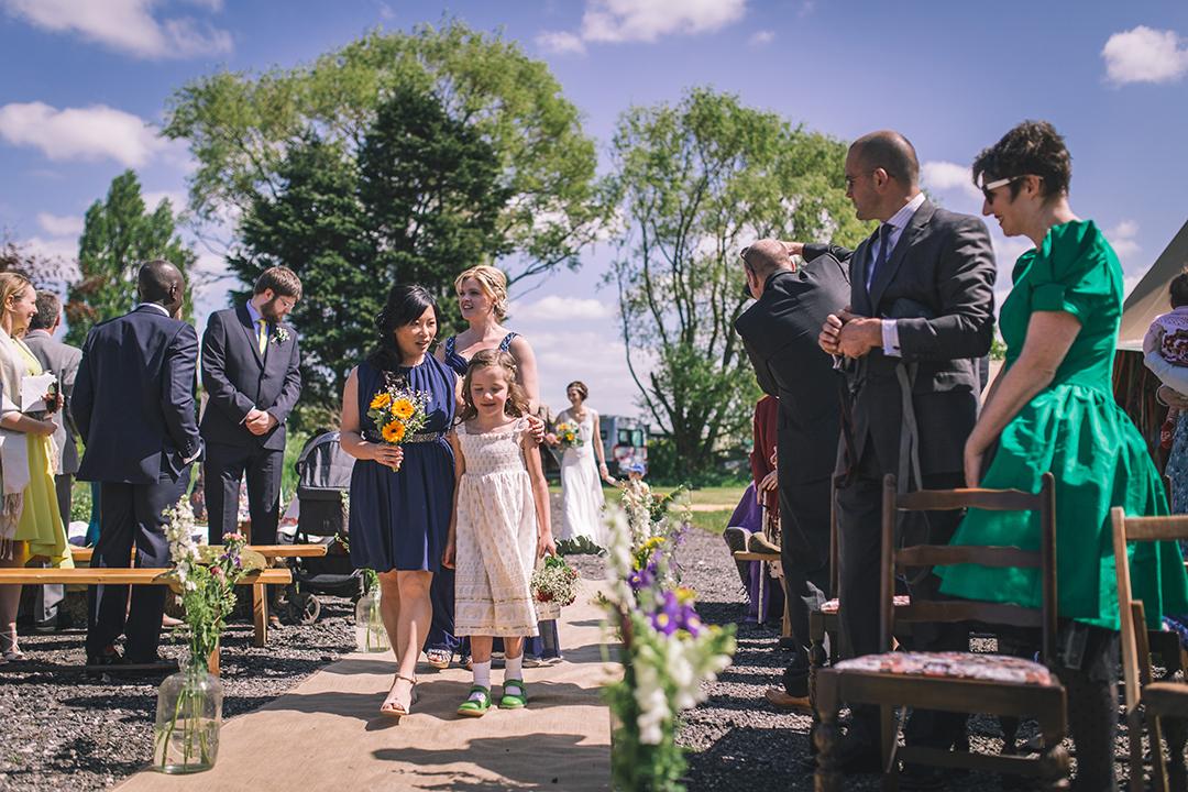 bridesmaids at an outdoor wedding ceremony