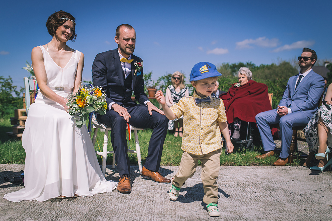 page boy with bow tie at a festival style wedding