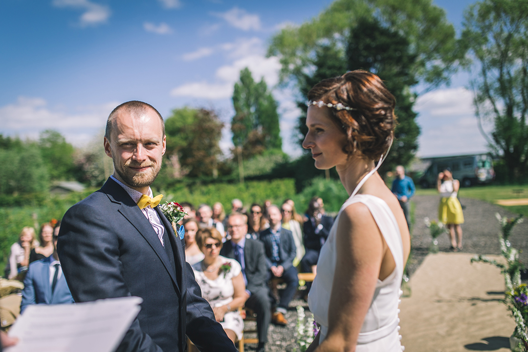 outdoor wedding ceremony at a festival style wedding