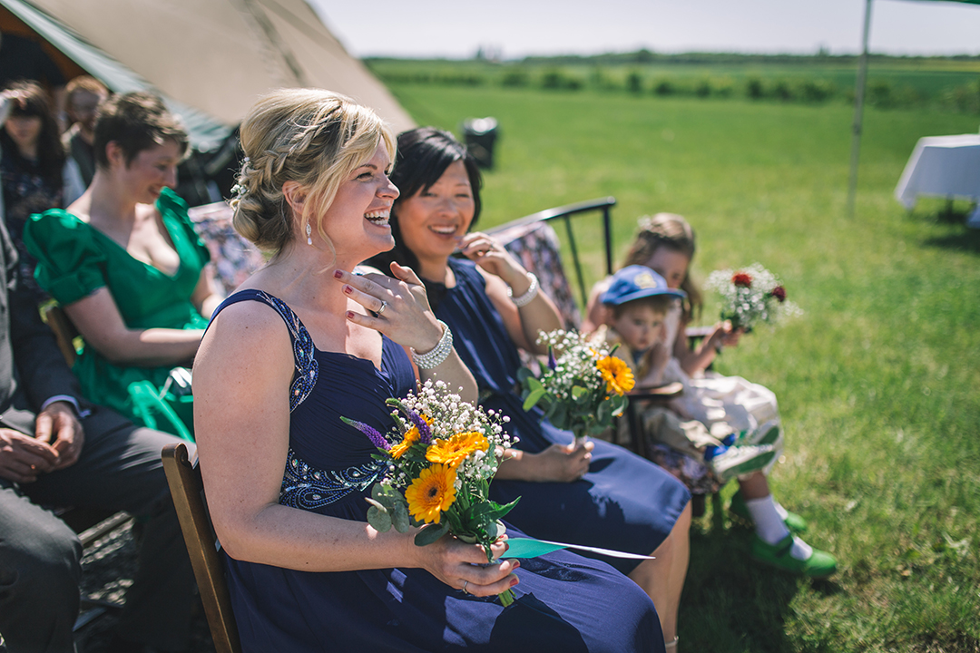 bridesmaids at an outdoor wedding ceremony at a festival style wedding