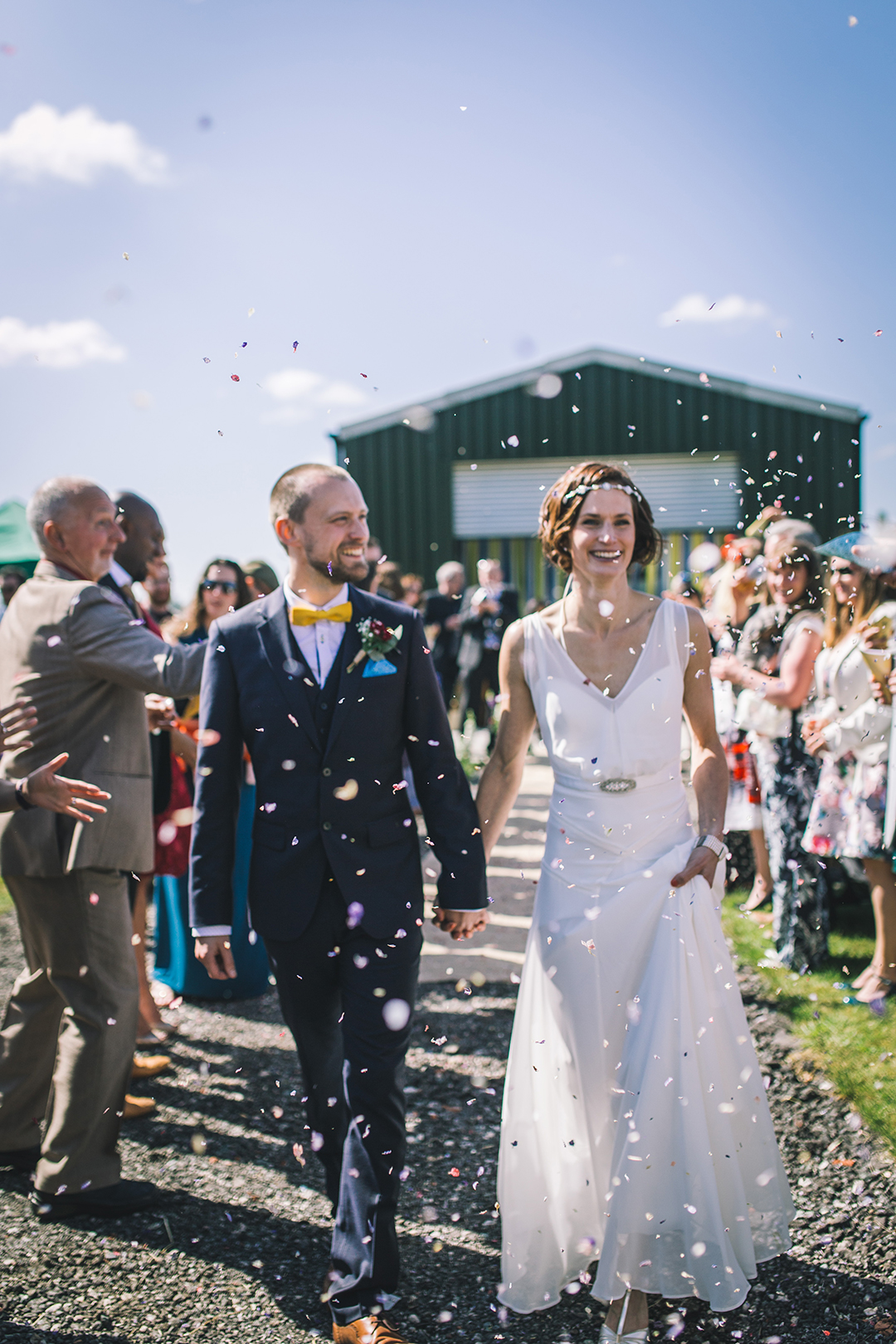 confetti shot at a festival style wedding