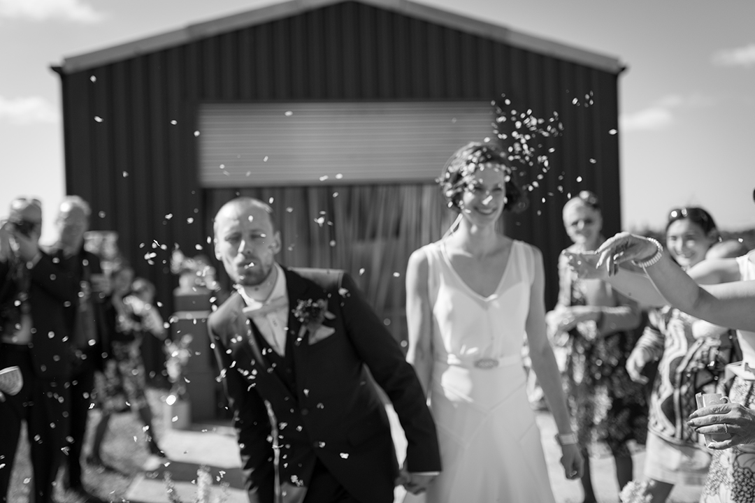 confetti shot in black and white at a festival style wedding