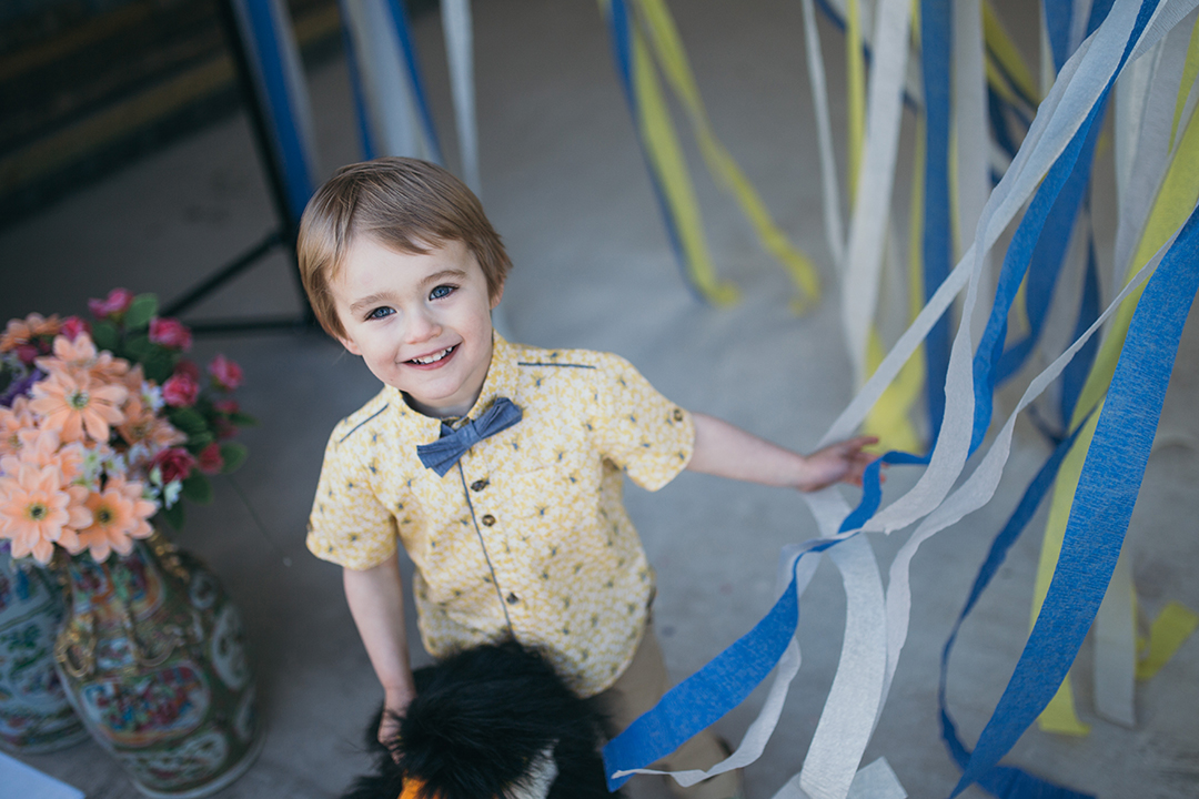 page boy holding streamers at a festival style wedding