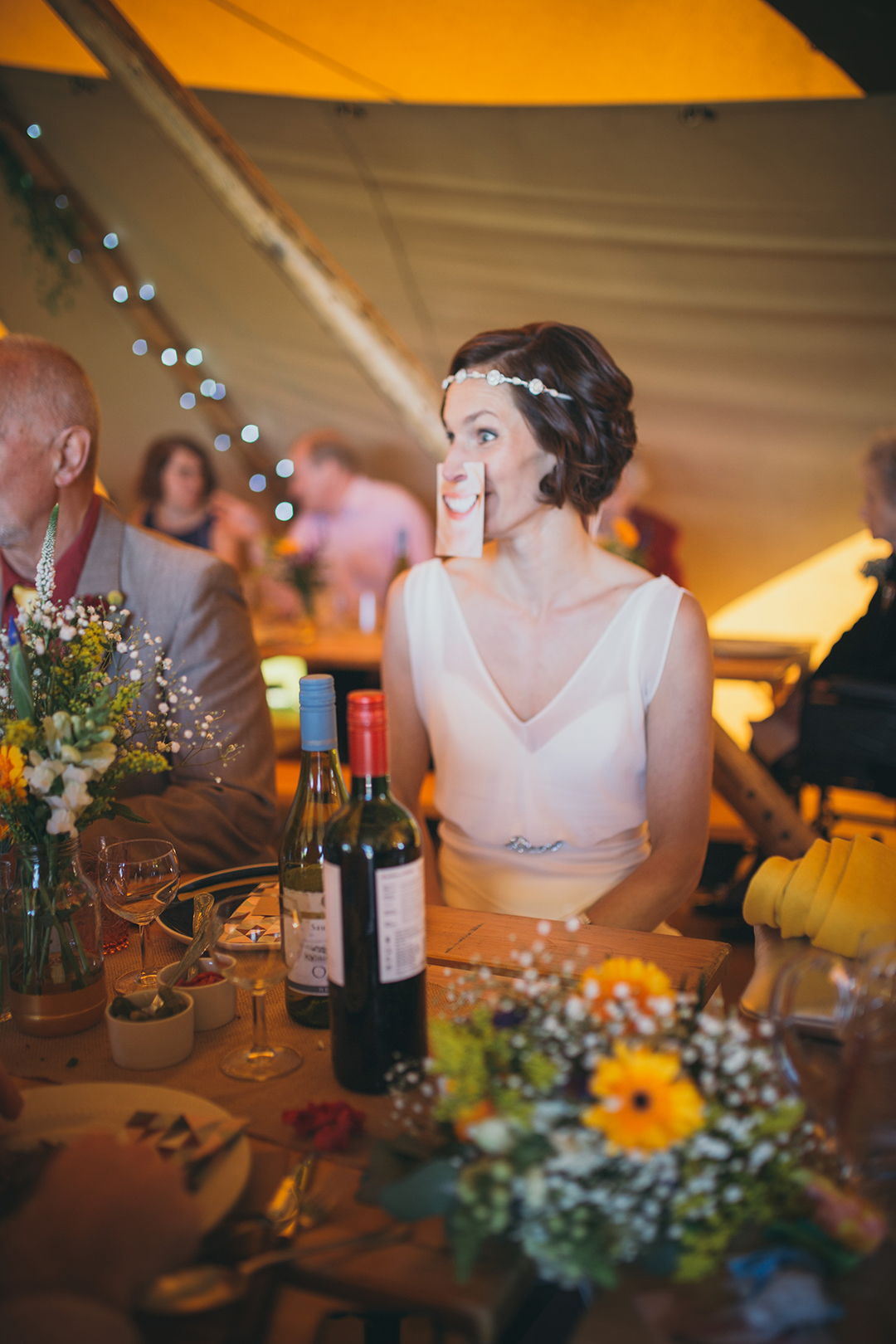 bride inside a tipi at a festival style wedding