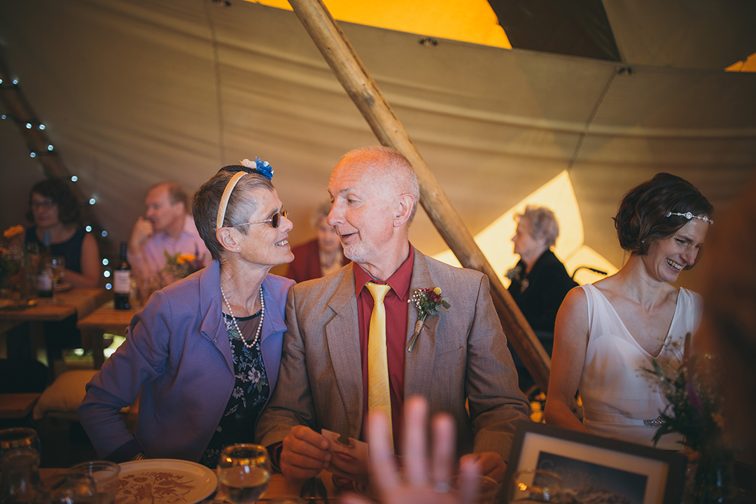 guests inside a tipi at a festival style wedding