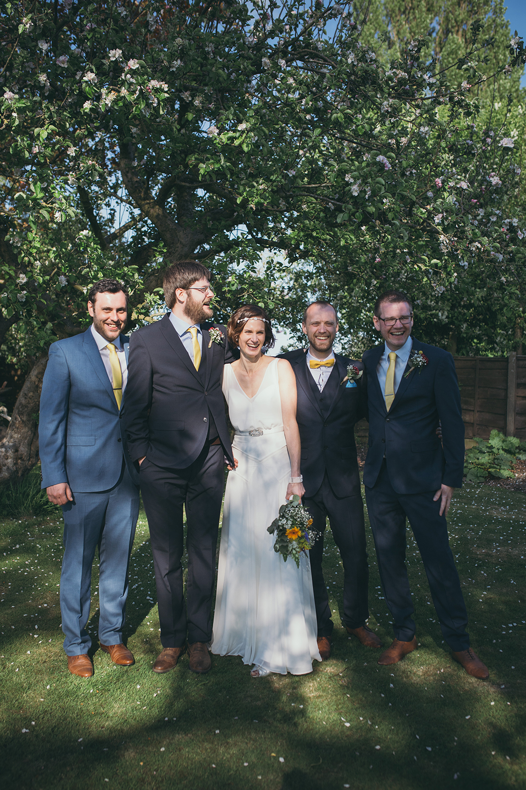 bride and groom with best man and ushers at a festival style wedding