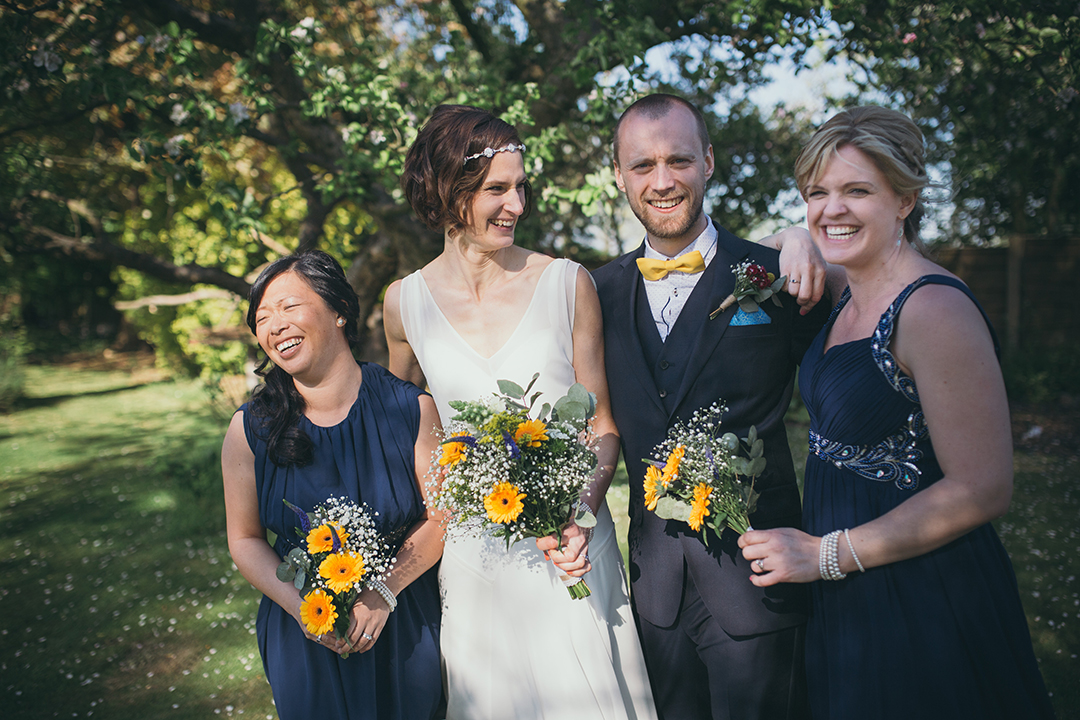 bride and groom with bridesmaids at a festival style wedding