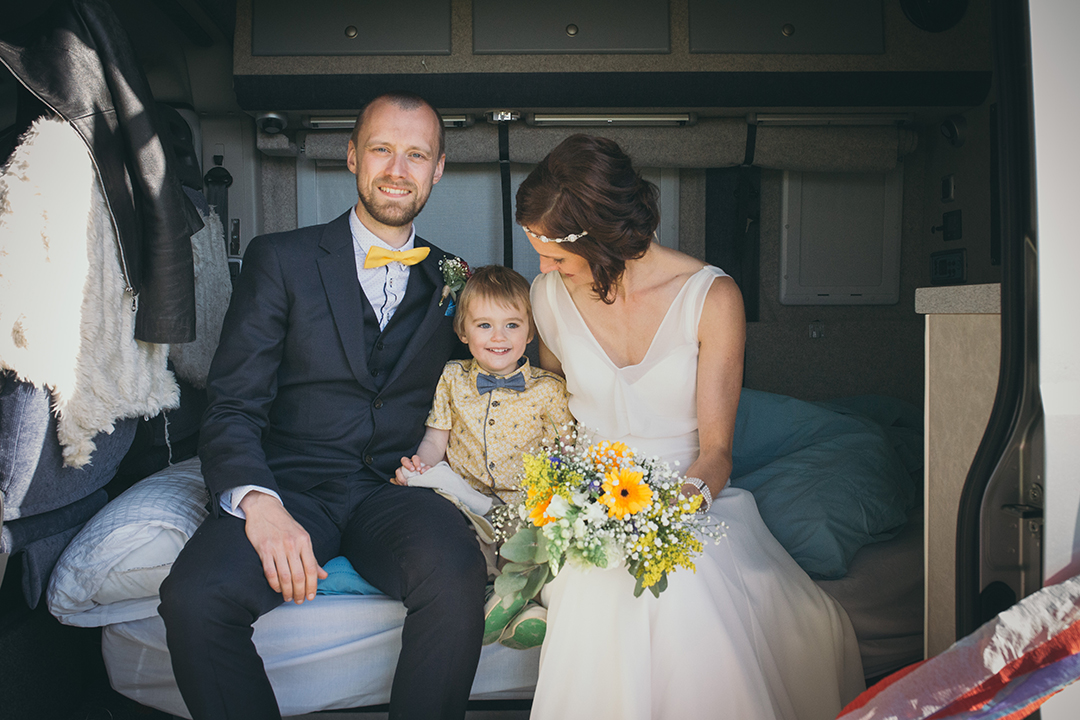 bride, groom and page boy at a festival style wedding