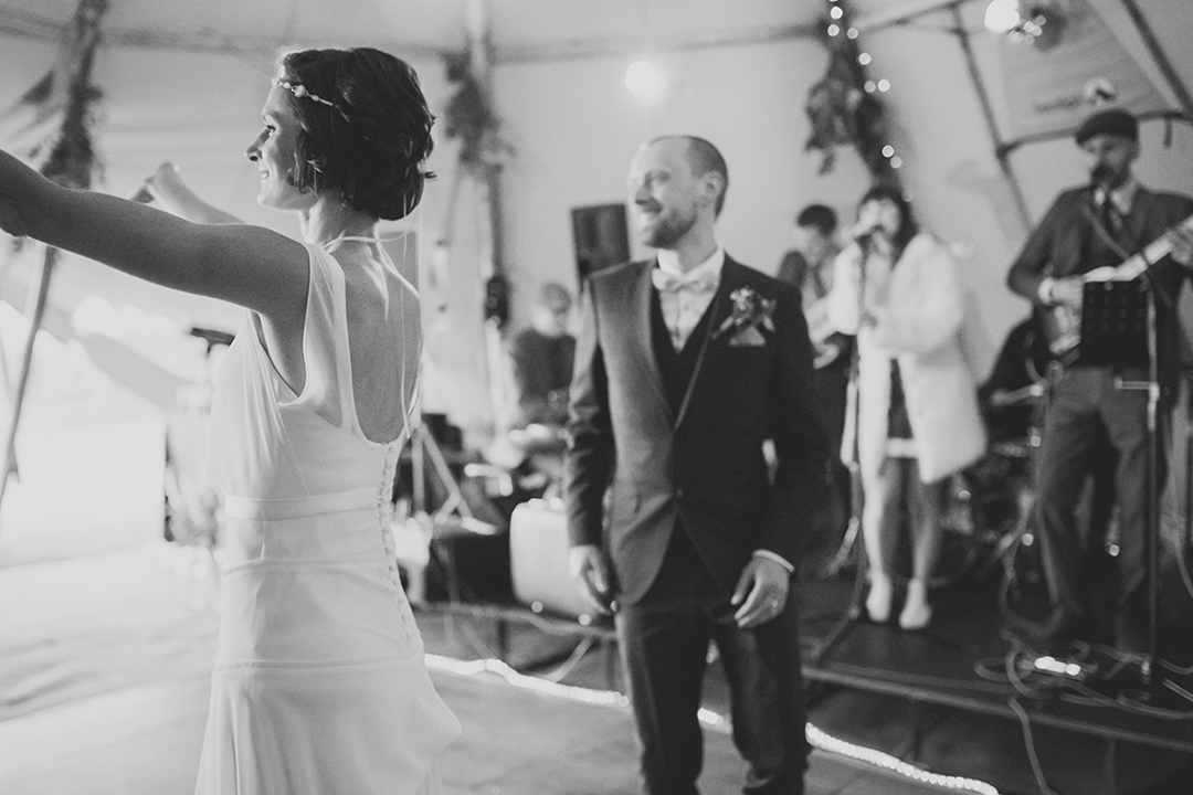 bride and groom dancing at a festival wedding