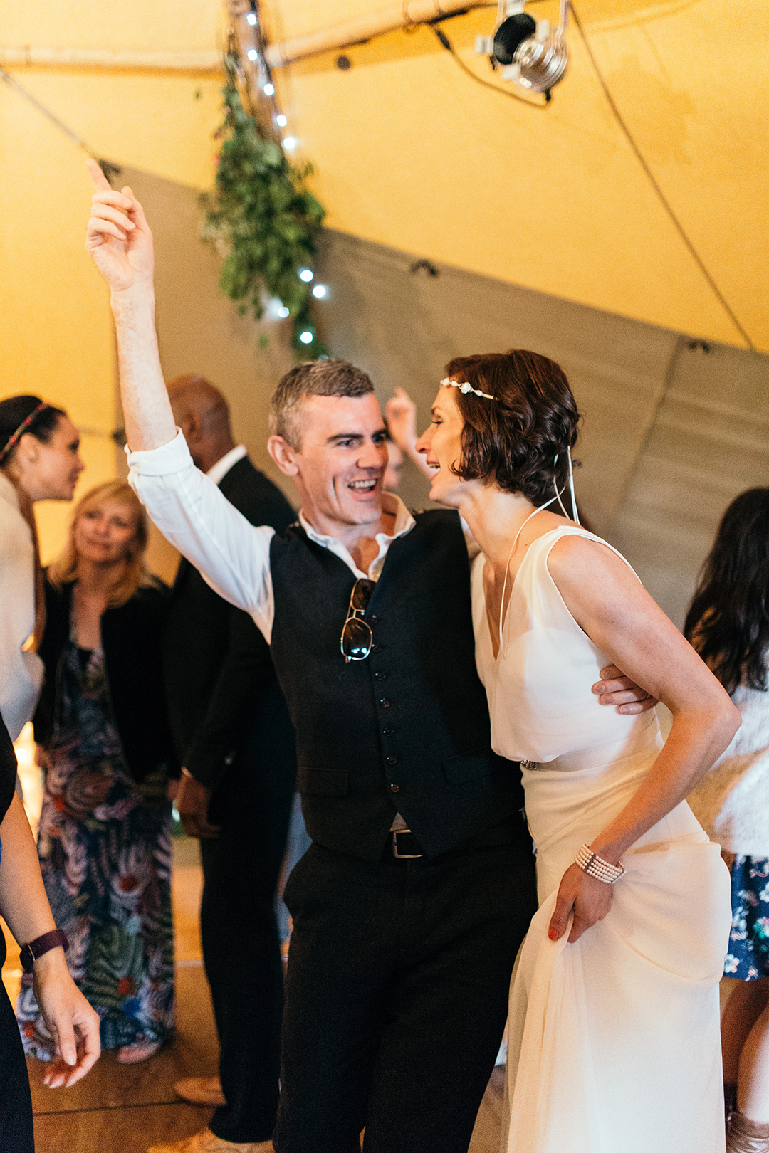 bride dancing in tipi at an outdoor festival wedding