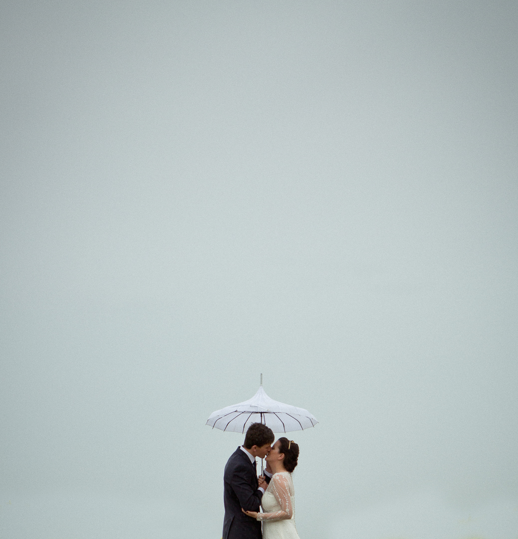 bride-and-groom-in-the-rain-elfestival-ellen-and-alex-real-festival-style-wedding
