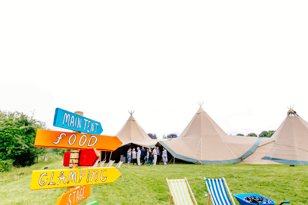 colourful-wedding-signs-and-tipi-glastonbury-themed-festival-wedding-els-photography