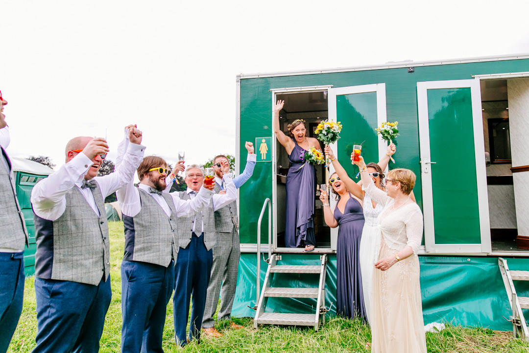 wedding-guests-outdoor-toilets-glastonbury-themed-festival-wedding-els-photography