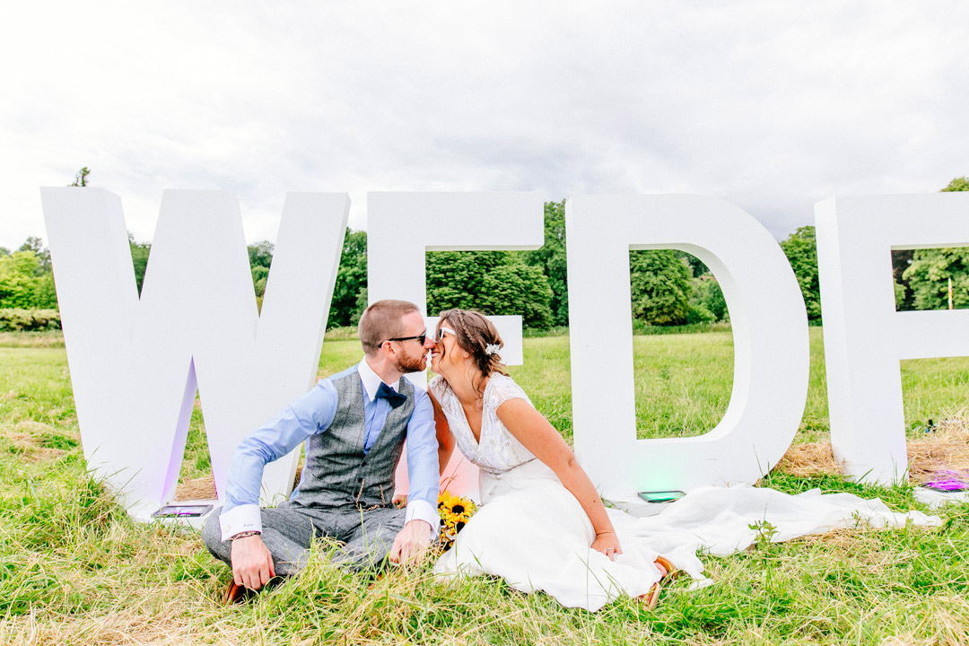 wedfest-sign-glastonbury-themed-festival-wedding-els-photography