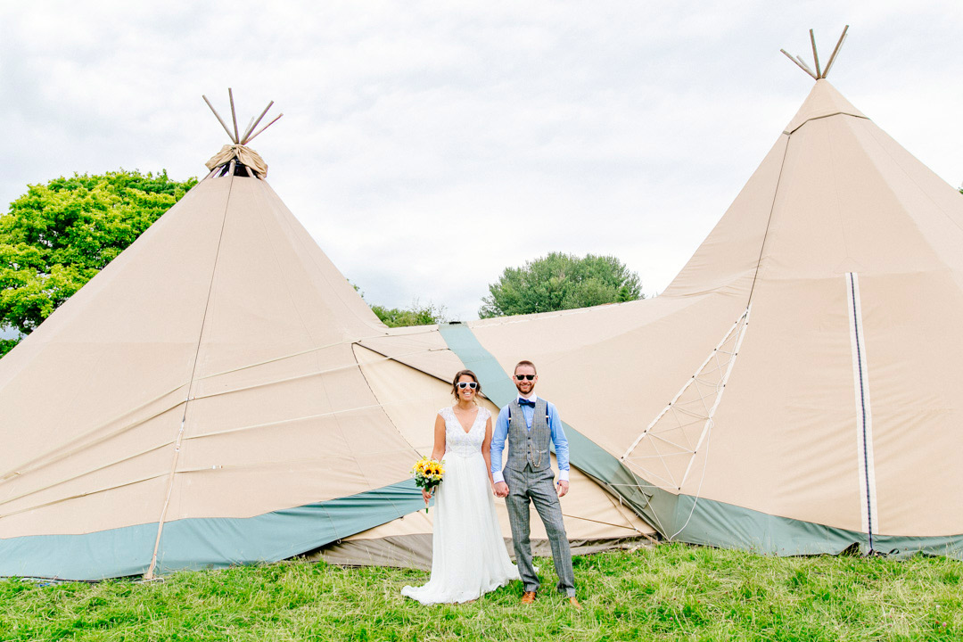 festival-bride-and-groom-stunning-tents-tipi-glastonbury-themed-festival-wedding-els-photography