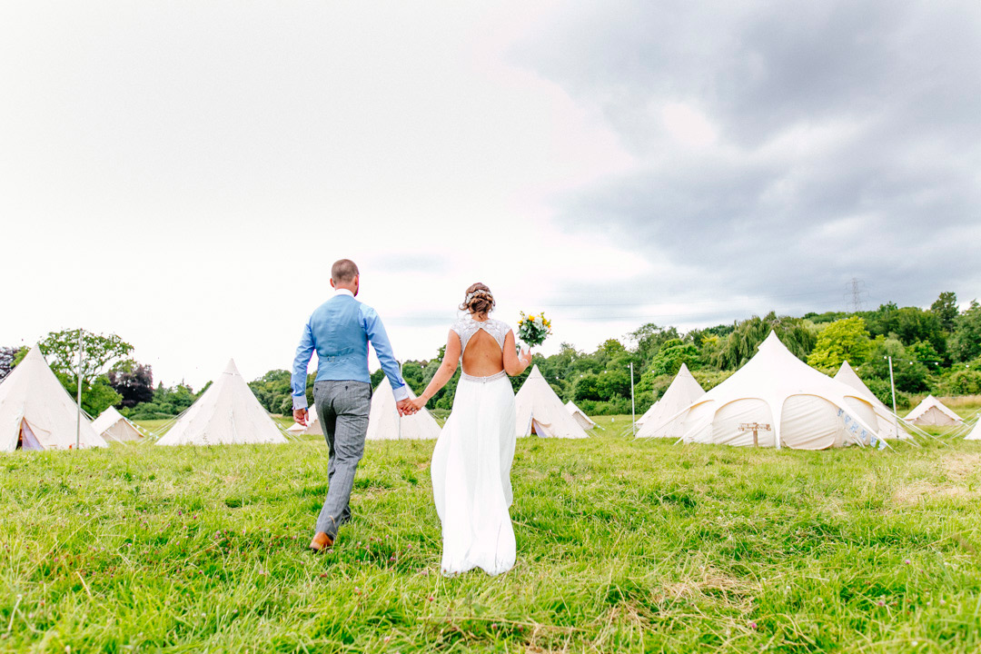 festival-bride-and-groom-bell-tents-glastonbury-themed-festival-wedding-els-photography