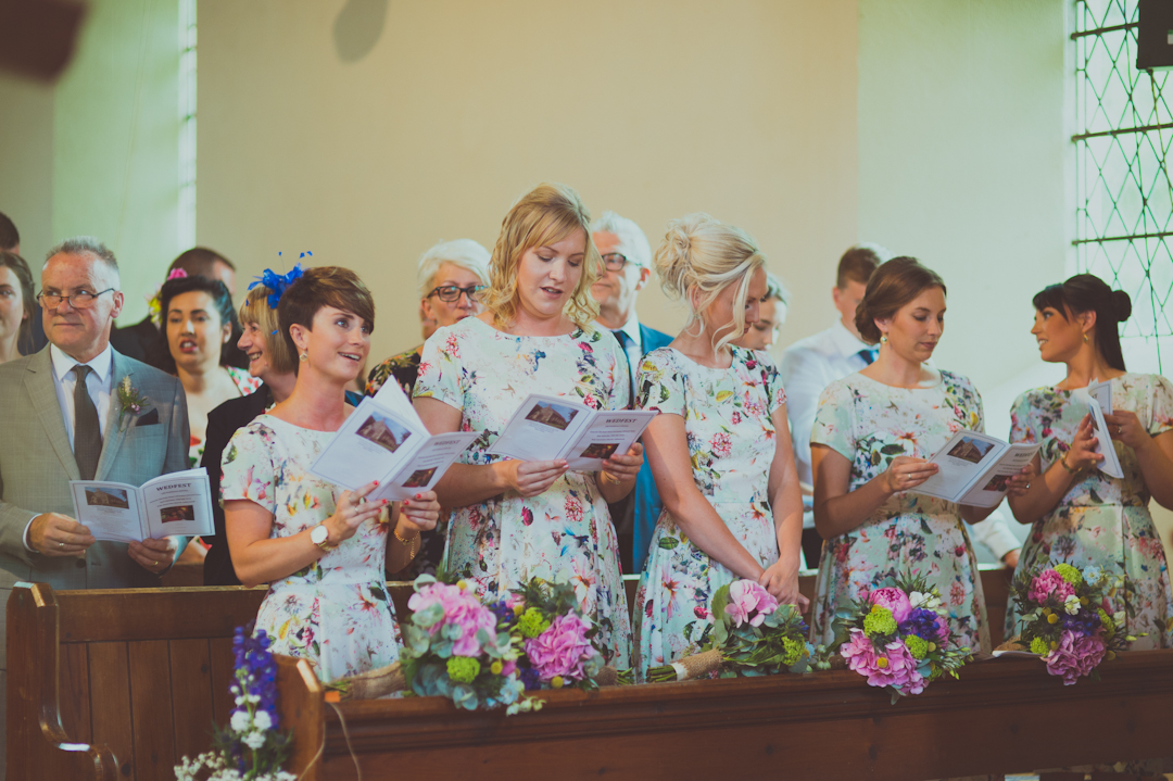 bridesmaids-in-floral-dress-vicky-and-james-festival-wedding