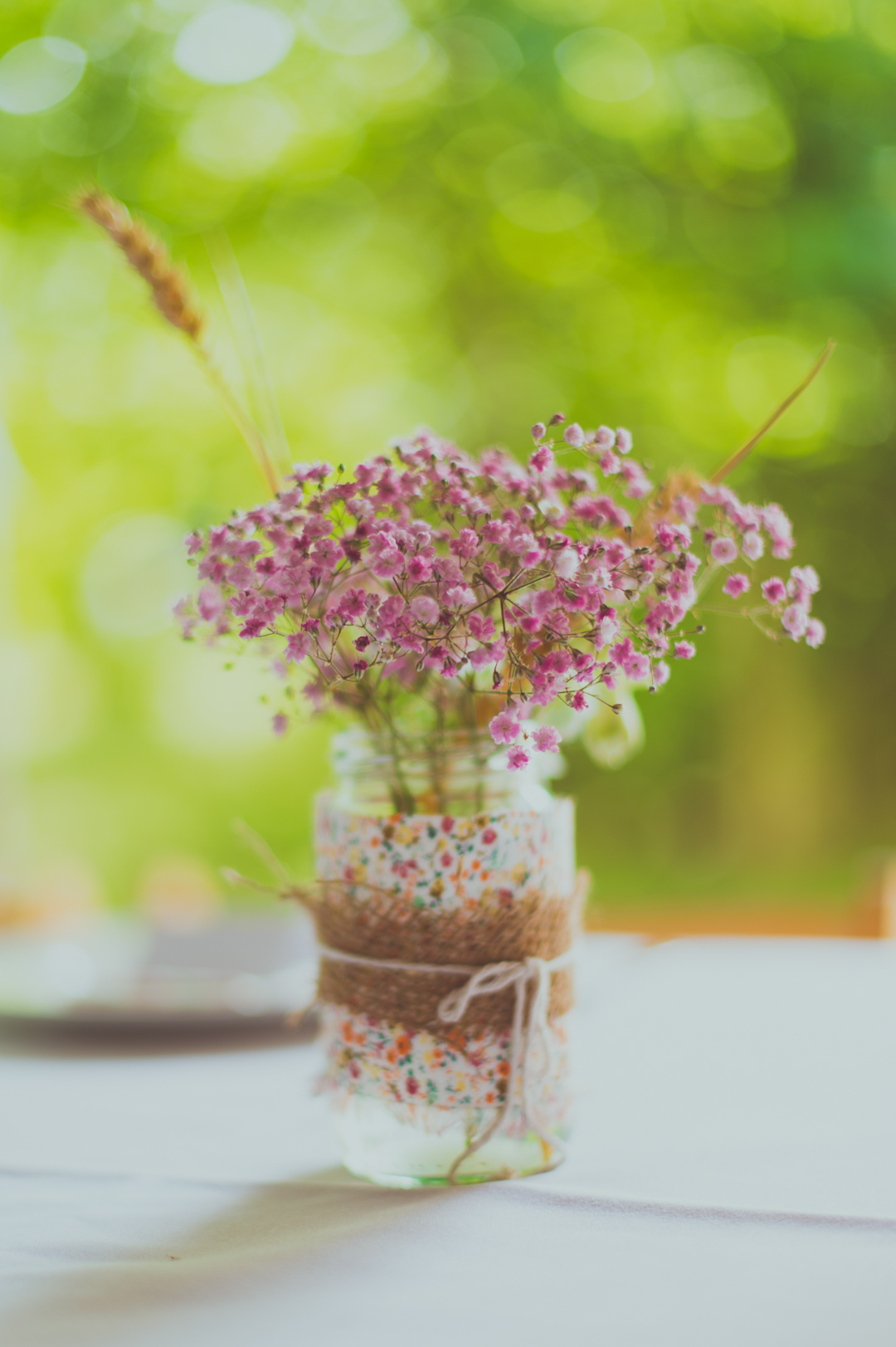 wild-flowers-in-DIY-jam-jars-vicky-and-james-festival-wedding