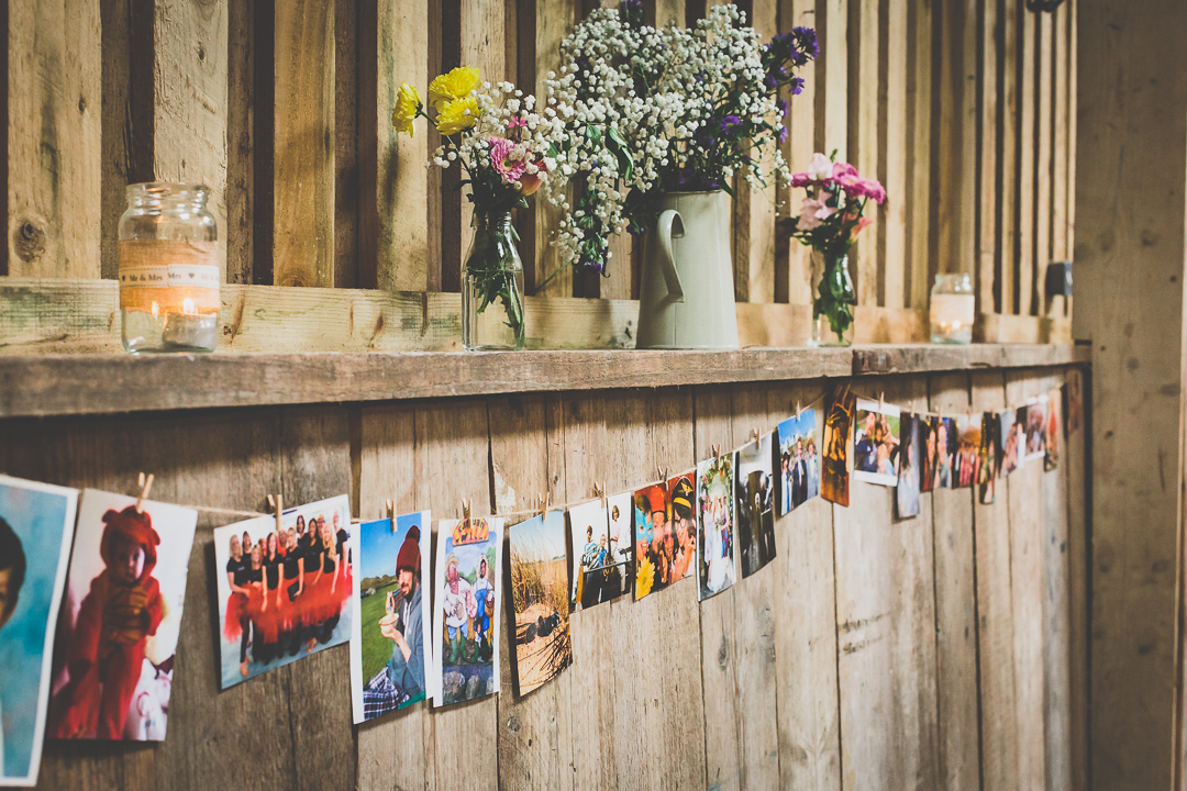 photowall-barn-decor-festival-style-wedding-in-devon-alexa-pope-photography