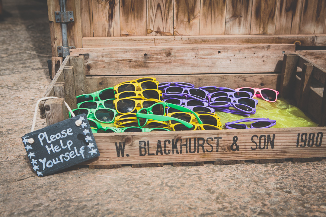colourful-sunglasses- festival-style-wedding-in-devon-alexa-pope-photography