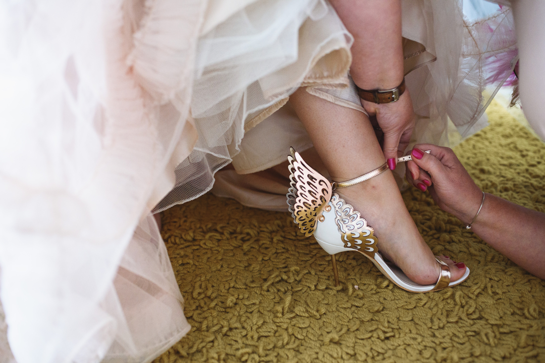 gold-butterfly-shoes-claire-and-simons-festival-wedding