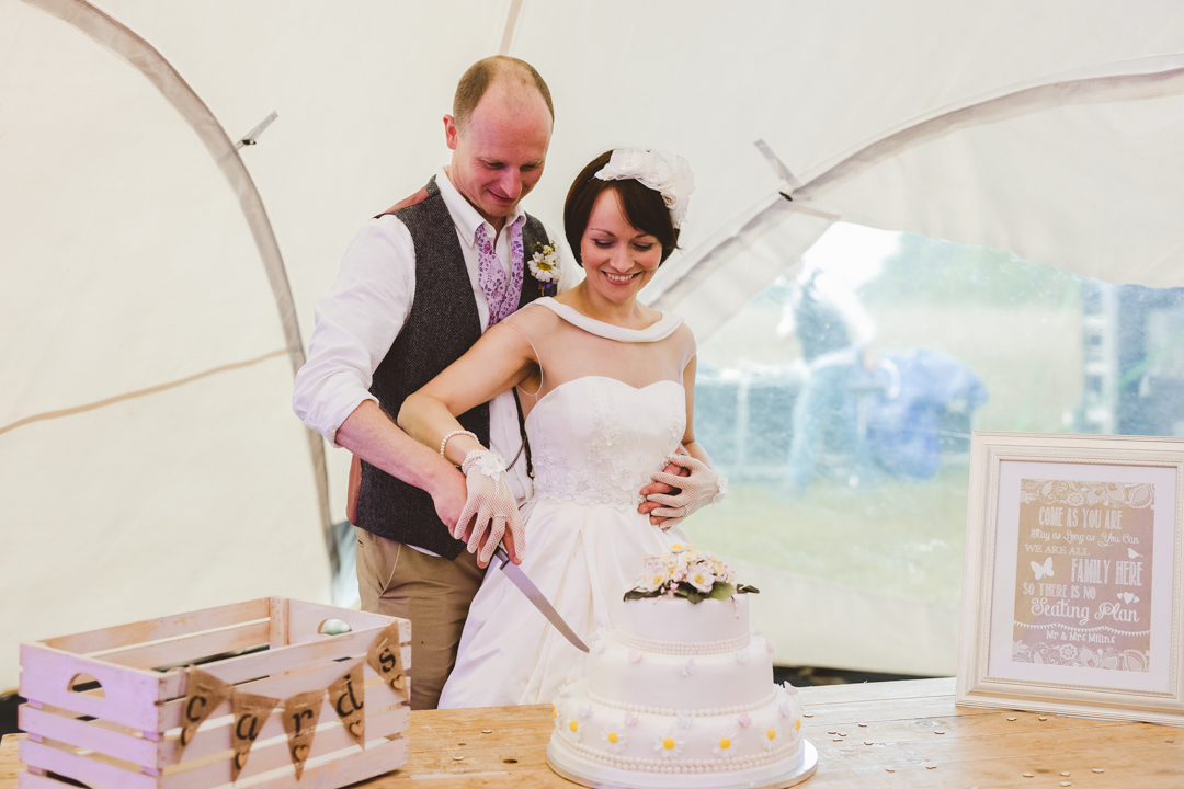 cutting-the-cake-jen-and-mat's-festival-wedding-at-Scraptoft farm