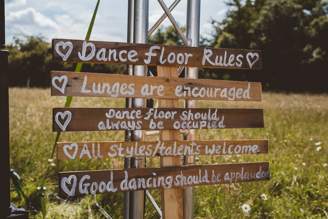 DIY-wooden-signs-jen-and-mat's-festival-wedding-at-Scraptoft farm