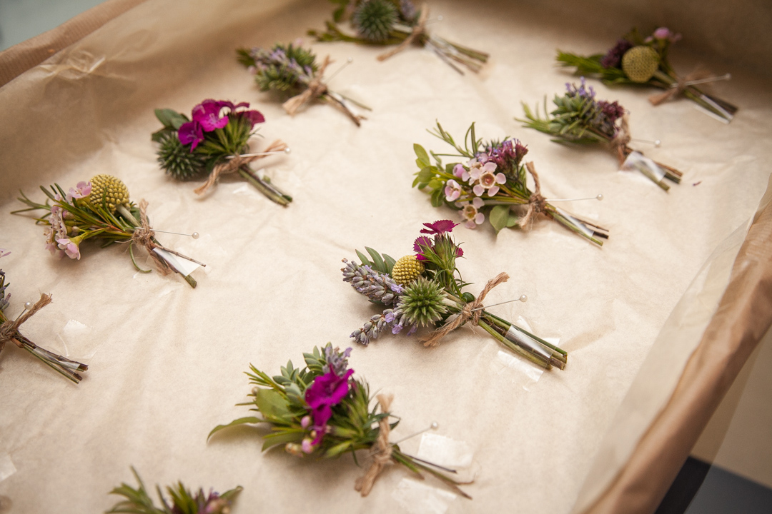 flower-button-holes-sara-and-tims-festival-wedding-joe-buford-photography