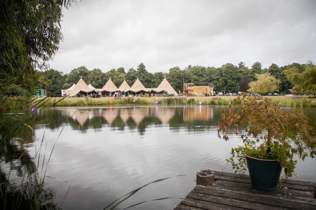 outdoor-venue-with-tipi-and-lake-sara-and-tims-festival-wedding