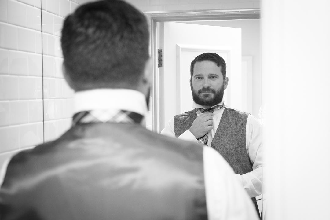 groom-getting-ready-sara-and-tims-festival-wedding-joe-buford-photography