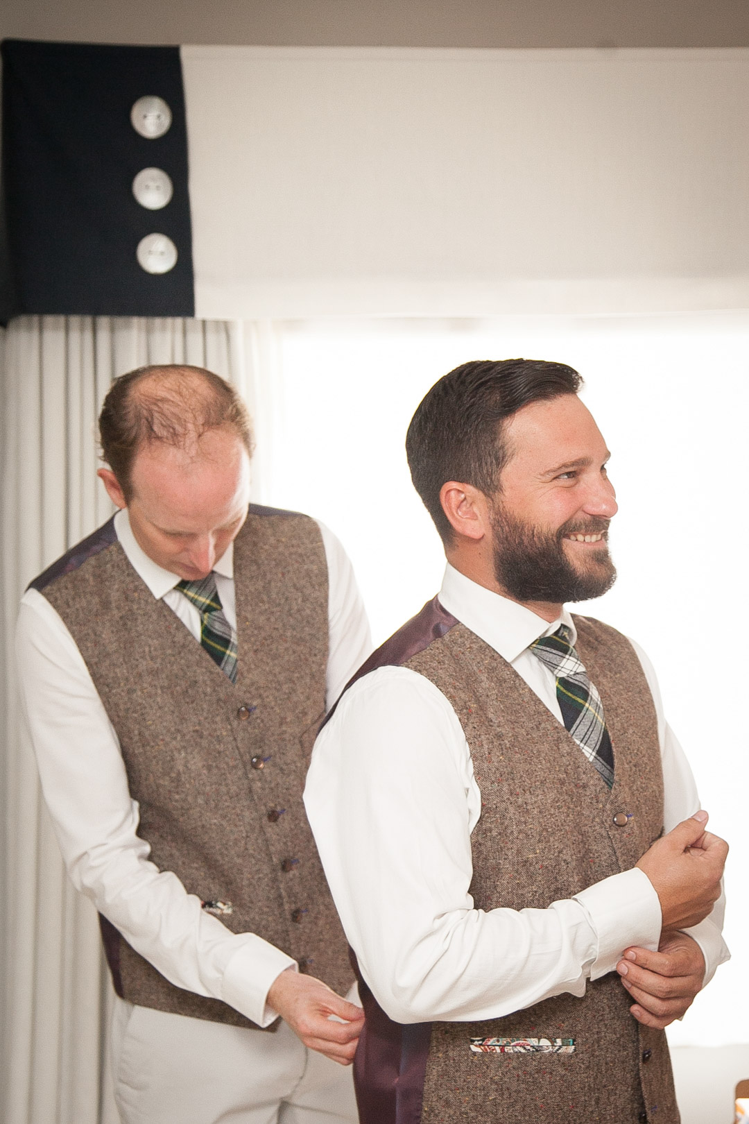 tweed-waistcoat-and-tartan-tie-sara-and-tims-festival-wedding-joe-buford-photography
