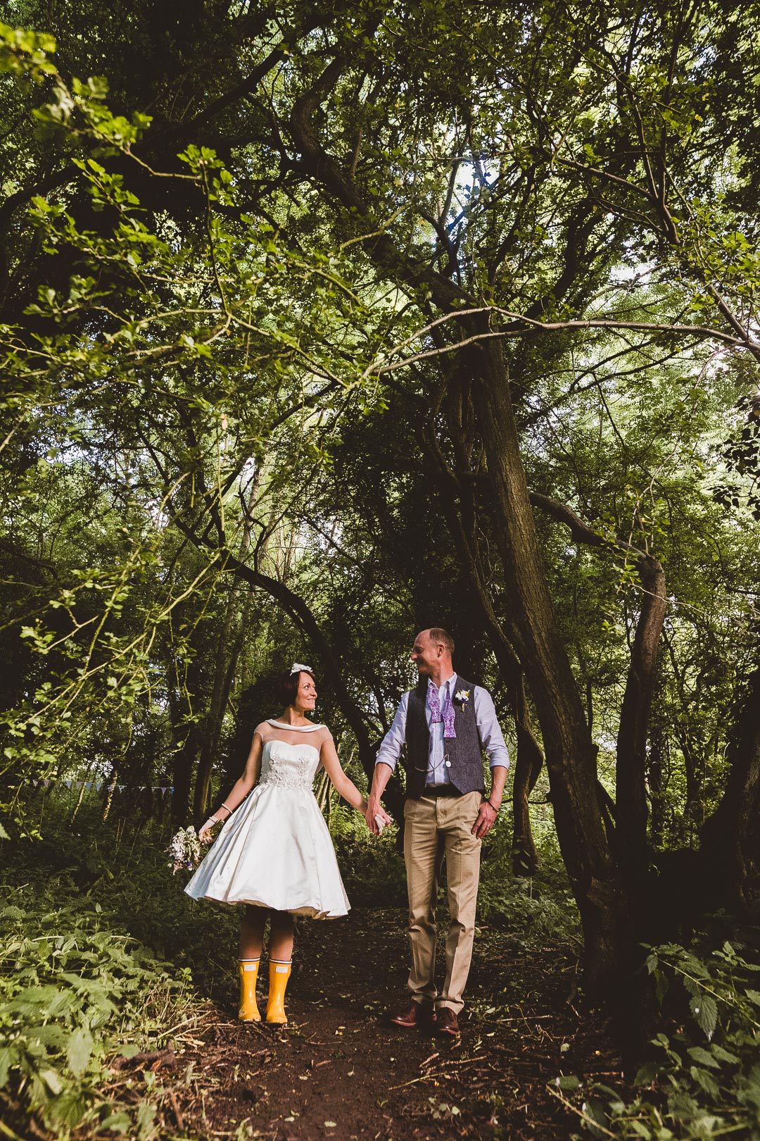 bride-and-groom-in-woodland-jen-and-mat's-festival-wedding-at-Scraptoft farm