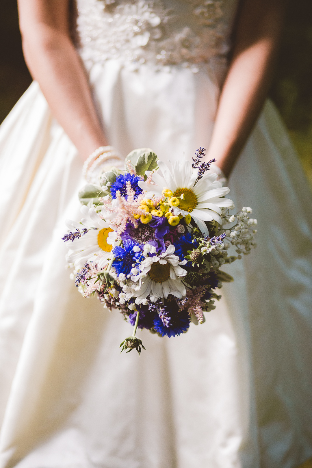blue-yellow-white-flower-bouquet-jen-and-mats-festival-style-wedding