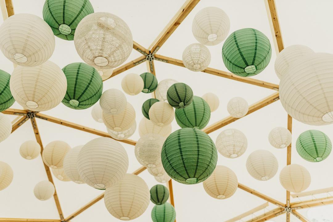 Hanging-pom-poms-wedding-decoration-ideas-BAYA-Domes-Steve-Bridgwood-Photo