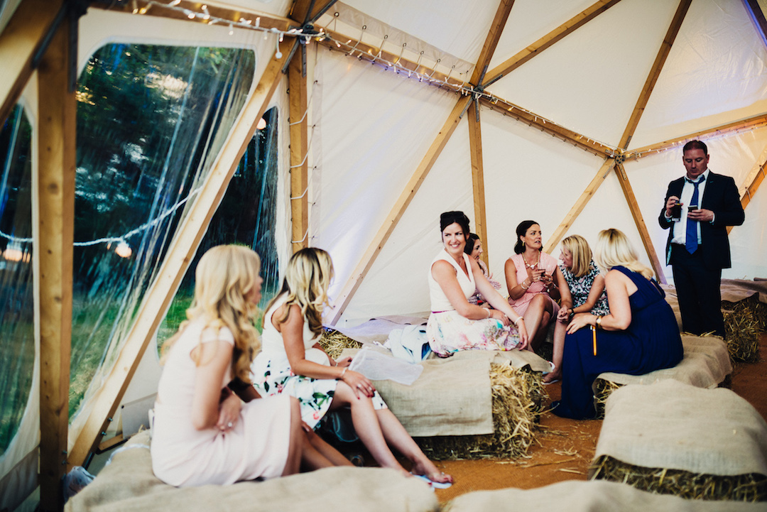 informal-wedding-seating-using-straw-bales-photo-Steve-bridgwood