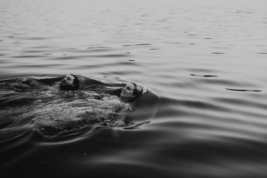 couple swimming in the water at Lake Casitas engagement shoot