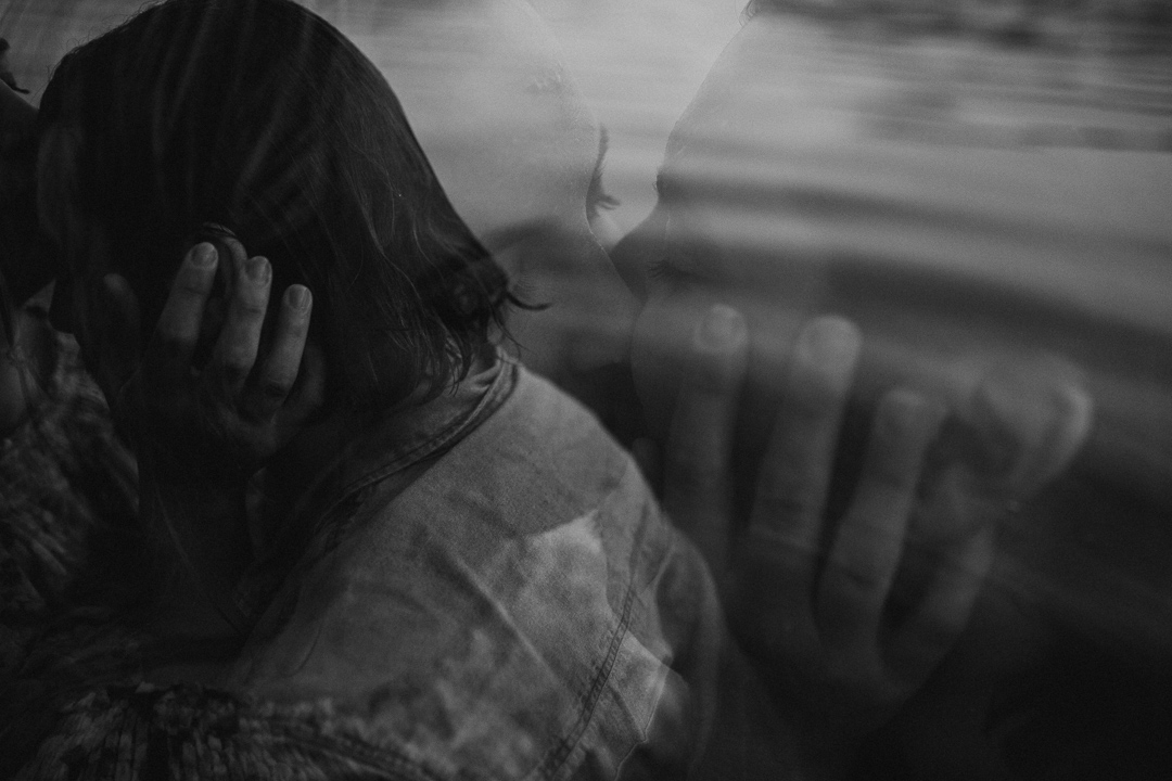 beautiful arty image of couple kissing at Lake Casitas engagement shoot
