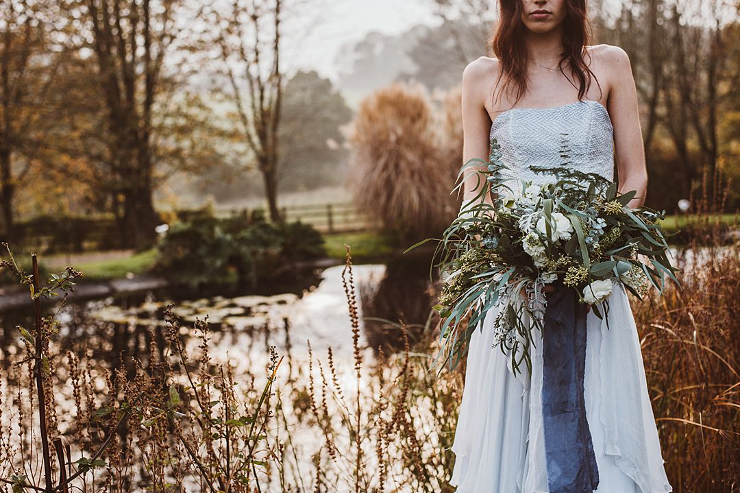 bride-with-wild-flower-bouquet-by-lake-knitted-bridal-seperates-and-corsets-designed-by-Jessica-Turner